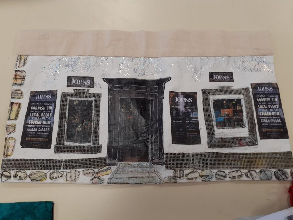 Textile collage of Johns Off Licence, Fore Street